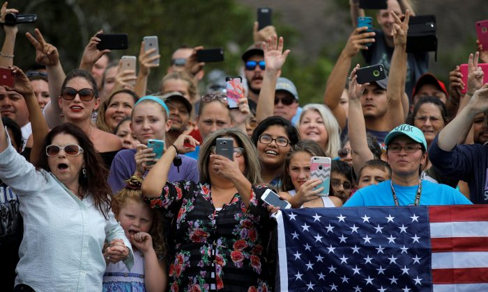 Hundreds of people gathered outside a fire station where President Donald Trump received a briefing in Corpus Christi, Texas, on Aug. 29, 2017. (REUTERS/Carlos Barria)