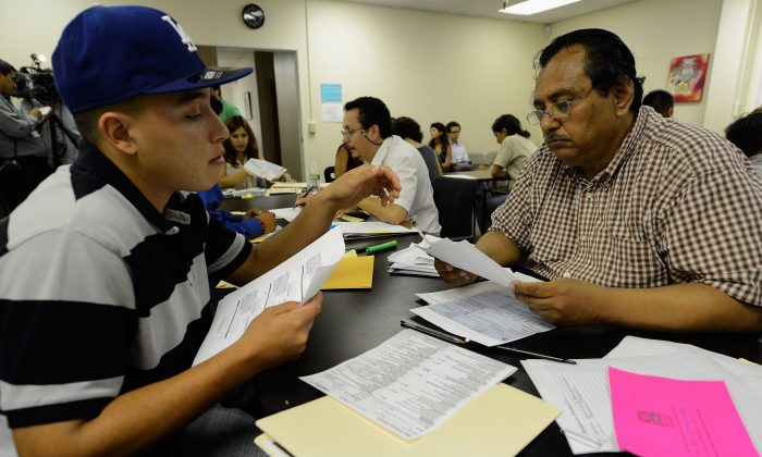 LOS ANGELES, CA - AUGUST 15:  Oscar Barrera-Gonzalez (L) receives help from volunteer Ivan Corpeno in filing up his application for Deferred Action for Childhood Arrivals program at Coalition for Humane Immigrant Rights of Los Angeles on August 15, 2012 in Los Angeles, California. Under a new program established by the Obama administration undocumented youth who qualify for the program, called Deferred Action for Childhood Arrivals, can file applications from the U.S. Citizenship and Immigration Services website to avoid deportation and obtain the right to work  (Photo by Kevork Djansezian/Getty Images)