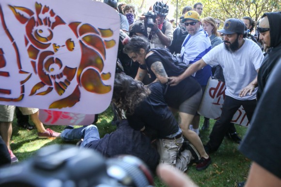 Antifa extremists attack a man at Martin Luther King Jr. Park in Berkeley, California, on Aug. 27, 2017. (AMY OSBORNE/AFP/Getty Images)