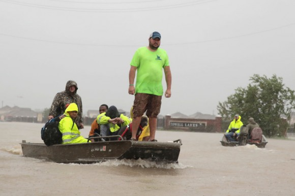 People are rescued from a flooded neighborhood after it was inundated with rain water, remnants of Hurricane Harvey, on August 28, 2017 in Houston, Texas. Harvey, which made landfall north of Corpus Christi late Friday evening, is expected to dump upwards to 40 inches of rain in areas of Texas over the next couple of days.  (Scott Olson/Getty Images)