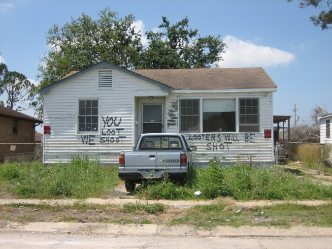 "New Orleans after Hurricane Katrina: House in formerly flooded neighborhood of Eastern New Orleans has ""You Loot We Shoot"" notice. Mazda pickup truck out front. (Infrogmation/Wikimedia Commons)"