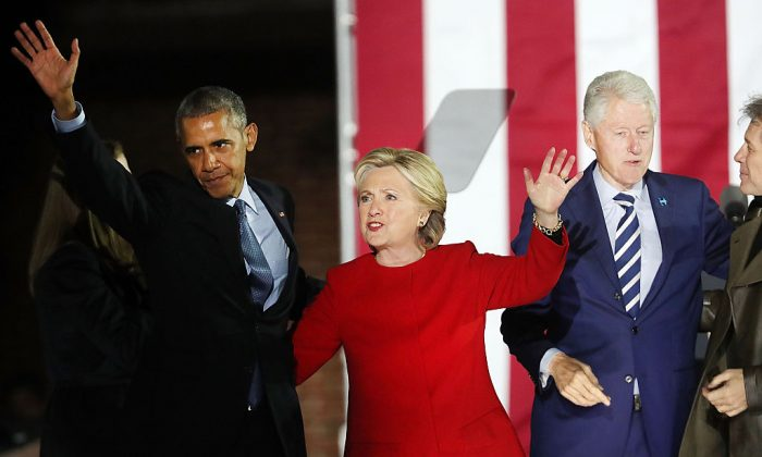 Former Secretary of State Hillary Clinton stands with former President Barack Obama during an election eve rally on Nov. 7, 2016, in Philadelphia. (Spencer Platt/Getty Images)