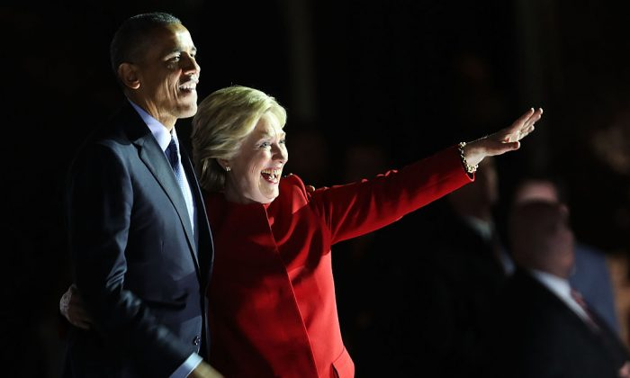 Democratic presidential nominee former Secretary of State Hillary Clinton stands with Barack Obama at an election eve rally on November 7, 2016 in Philadelphia, Pennsylvania. (Spencer Platt/Getty Images)