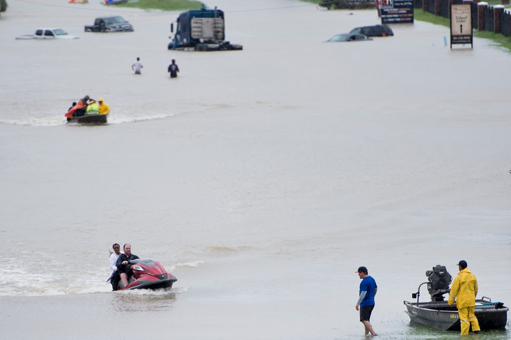 Volunteer rescuers evacuate people from a flooded residential area during the aftermath of Hurricane Harvey on August 29, 2017 in Houston, Texas. Floodwaters have breached a levee south of the city of Houston, officials said Tuesday, urging residents to leave the area immediately.  (BRENDAN SMIALOWSKI/AFP/Getty Images)