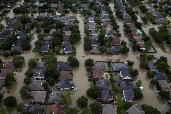 Houses are seen submerged in flood waters caused by Tropical Storm Harvey in Northwest Houston, Texas, U.S. August 30, 2017. (REUTERS/Adrees Latif)
