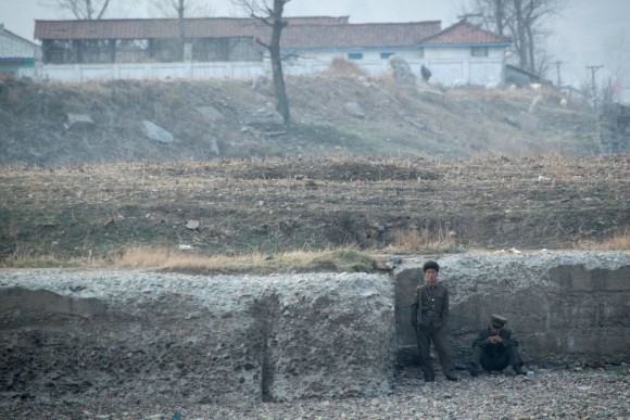 North Korean soldiers are seen on the banks of the Yalu river near Sinuiju, opposite the Chinese border city of Dandong, on April 15, 2017. (JOHANNES EISELE/AFP/Getty Images)
