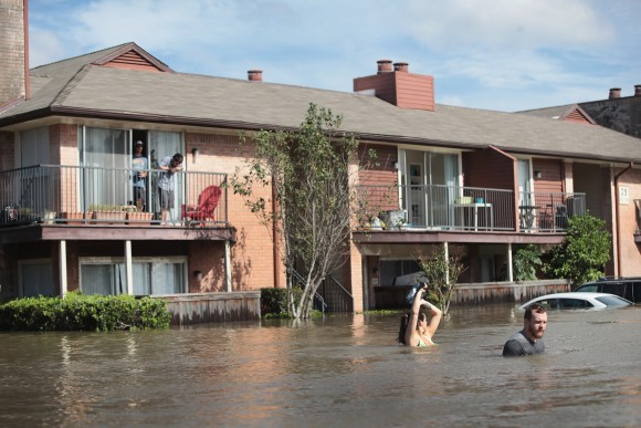 Residents wait for rescue at an apartment complex after it was inundated with water following Hurricane Harvey on August 30, 2017 in Houston, Texas.  (Scott Olson/Getty Images)
