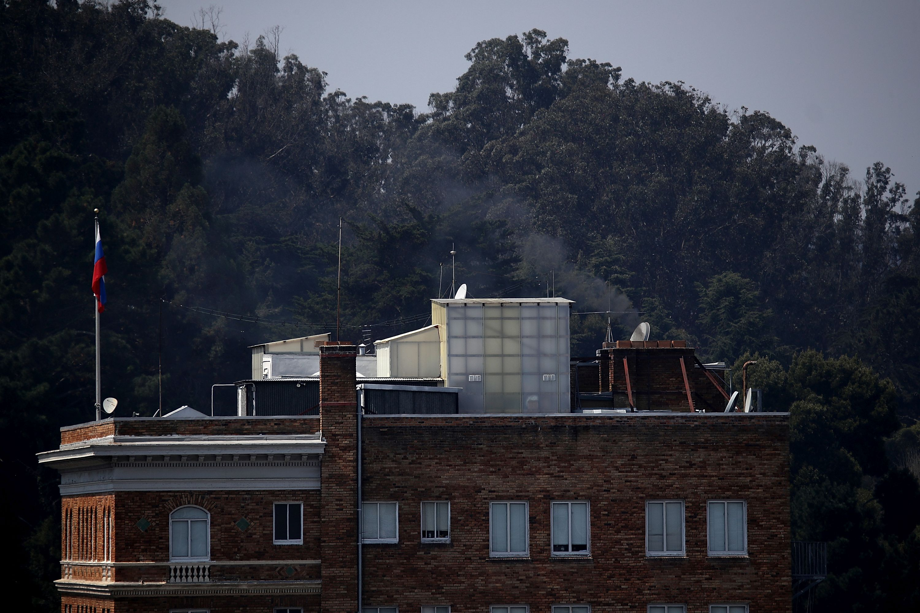 SAN FRANCISCO, CA - SEPTEMBER 01:  Black smoke billows from a chimney on top of the Russian consulate on September 1, 2017 in San Francisco, California. In response to a Russian government demand for the United States to cut its diplomatic staff in Russia by 455, the Trump administration ordered the closure of three consular offices in the San Francisco, New York and Washington.  (Photo by Justin Sullivan/Getty Images)