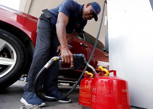 Cains Lawrence fills gasoline cans at the Fuel City service station in the aftermath of Hurricane Harvey, in Dallas, Texas, U.S., September 1, 2017.  (REUTERS/Brandon Wade)