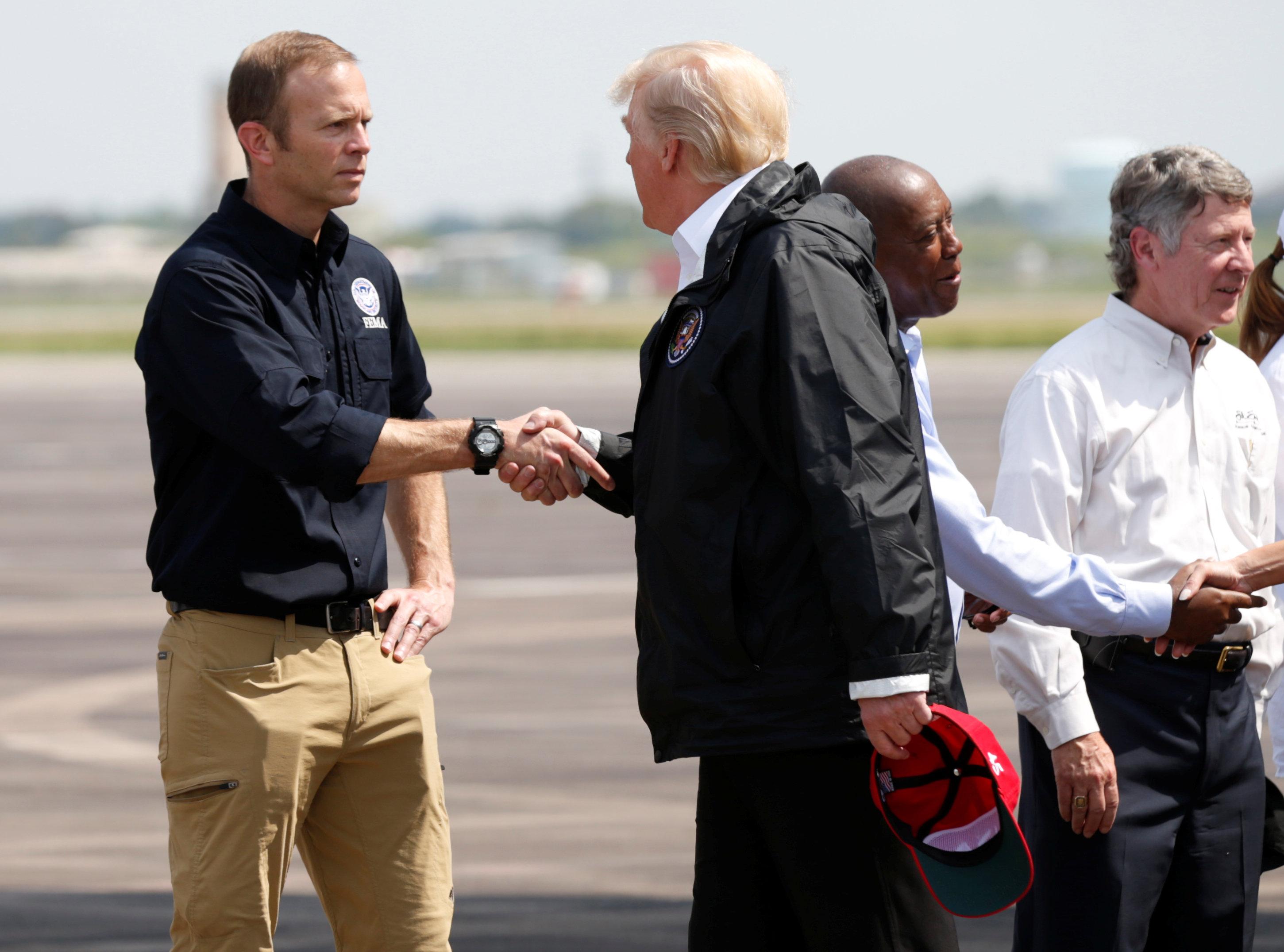 U.S. President Donald Trump meets FEMA Director Brock Long (REUTERS/Kevin Lamarque)