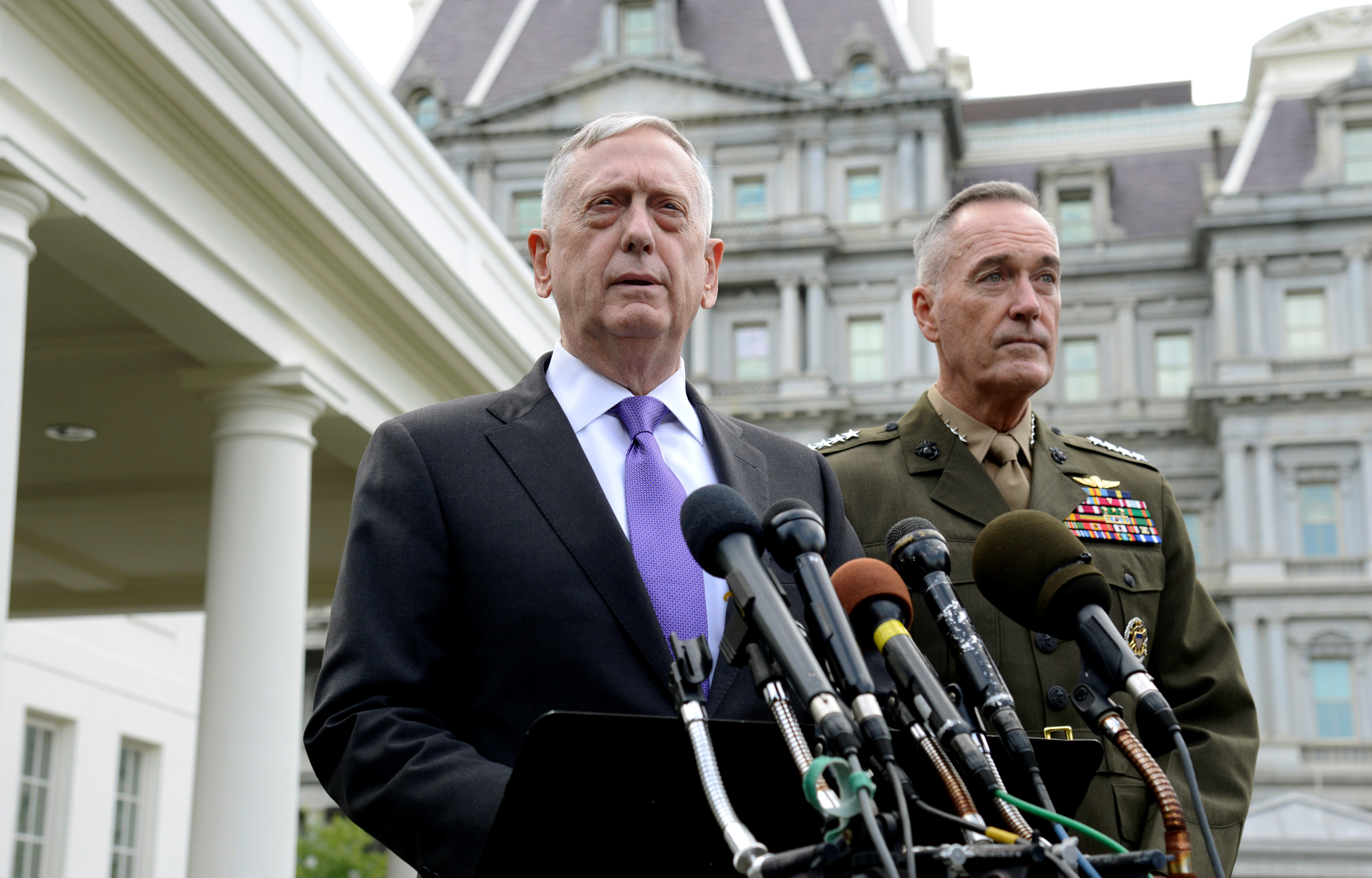 Secretary of Defense James Mattis (L) makes a statement outside the West Wing of the White House in response to North Korea's latest nuclear testing, as Chairman of the Joint Chiefs of Staff Gen. Joseph Dunford listens, in Washington, U.S., September 3, 2017.   REUTERS/Mike Theiler