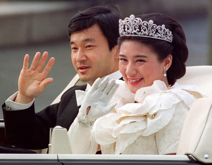 This file photo dated 9 June, 1993, shows Japanese Crown Prince Naruhito (L) and Crown Princess Masako (R) waving to people during the parade after their wedding ceremony in Tokyo. (AFP/AFP/Getty Images)