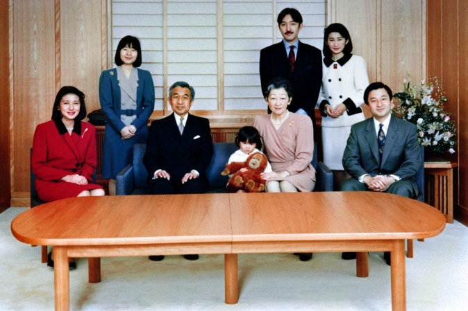 The Japanese Imperial family get together at the Imperial Palace on December 16, 1994 during a photo session for the New Year. Princess Masako (L) became a happy member of the family in this year's session following the July marriage with Crown Prince Naruhito (R). (L-R) Crown Princess Masako, Princess Nori, Emperor Akihito, Princess Mako, Empress Michiko, Prince Akishino, Princess Kiko and Crown Prince Naruhito.  (AFP/Getty Images)