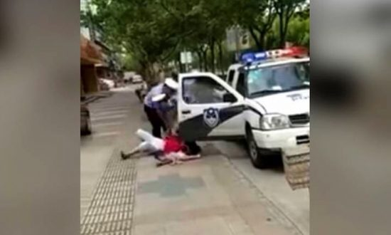 Video of Chinese Police Officer Slamming Woman, Child Draws Ire