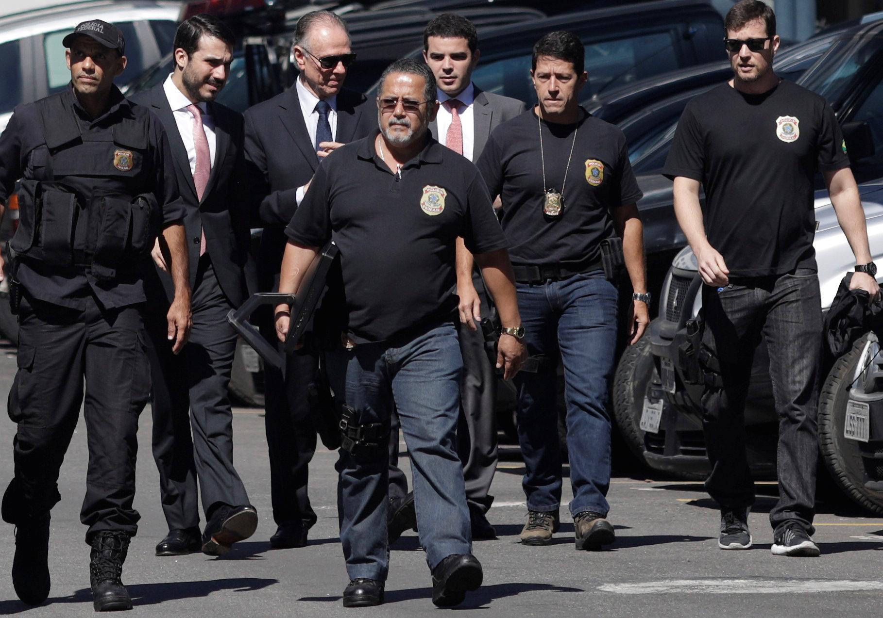 Brazilian Olympic Committee (COB) President Carlos Arthur Nuzman arrives to Federal Police headquarters in Rio de Janeiro, Brazil on Sept. 5, 2017. (REUTERS/Ricardo Moraes)