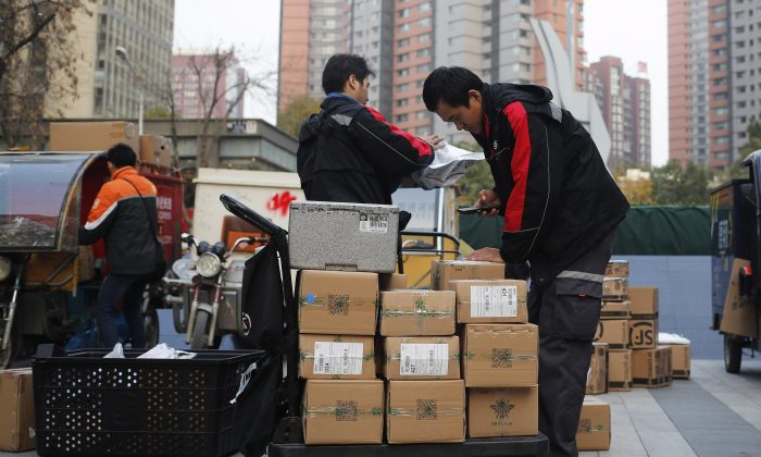 "Delivery workers sort parcels for their customers in Beijing, China on ""Singles Day,"" a holiday that has grown into the world's busiest day for e-commerce, Nov. 11, 2016. (AP Photo/Andy Wong)"