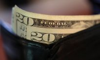 Woman Chases Wallet Full of Money, Finds Herself $2,000 Poorer