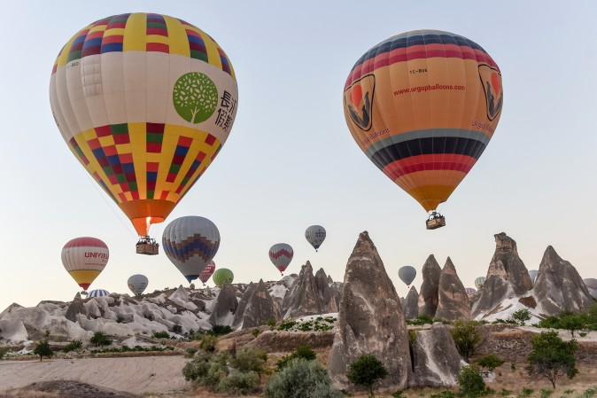 Hot air balloons glide during a flight over Nevsehir in Turkey's historical Cappadocia region, Central Anatolia, on Sept. 5. (YASIN AKGUL/AFP/Getty Images)