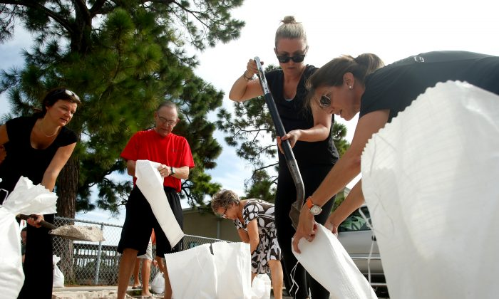Residents fill sandbags for each other at Bobby Hicks Park ahead of Hurricane Irma on September 5, 2017 in Tampa, Florida.  The National Hurricane Center (NHC) has reported that  Hurricane Irma has strengthened to a Category 5 storm as it crosses into the Caribbean and is expected to move on towards Florida.  (Brian Blanco/Getty Images)