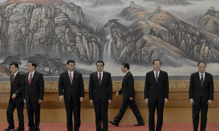 The Chinese Communist Party introduces its new Politburo Standing Committee after the last National Congress in 2012, at the Great Hall of the People in Beijing on Nov. 15, 2012. Five of the members of the top party organ are now set to retire: (L-R) Liu Yunshan (set to retire), Zhang Dejiang (set to retire), Xi Jinping, Li Keqiang, Zhang Gaoli (set to retire), Yu Zhengsheng (set to retire) and Wang Qishan (set to retire).  (MARK RALSTON/AFP/Getty Images)