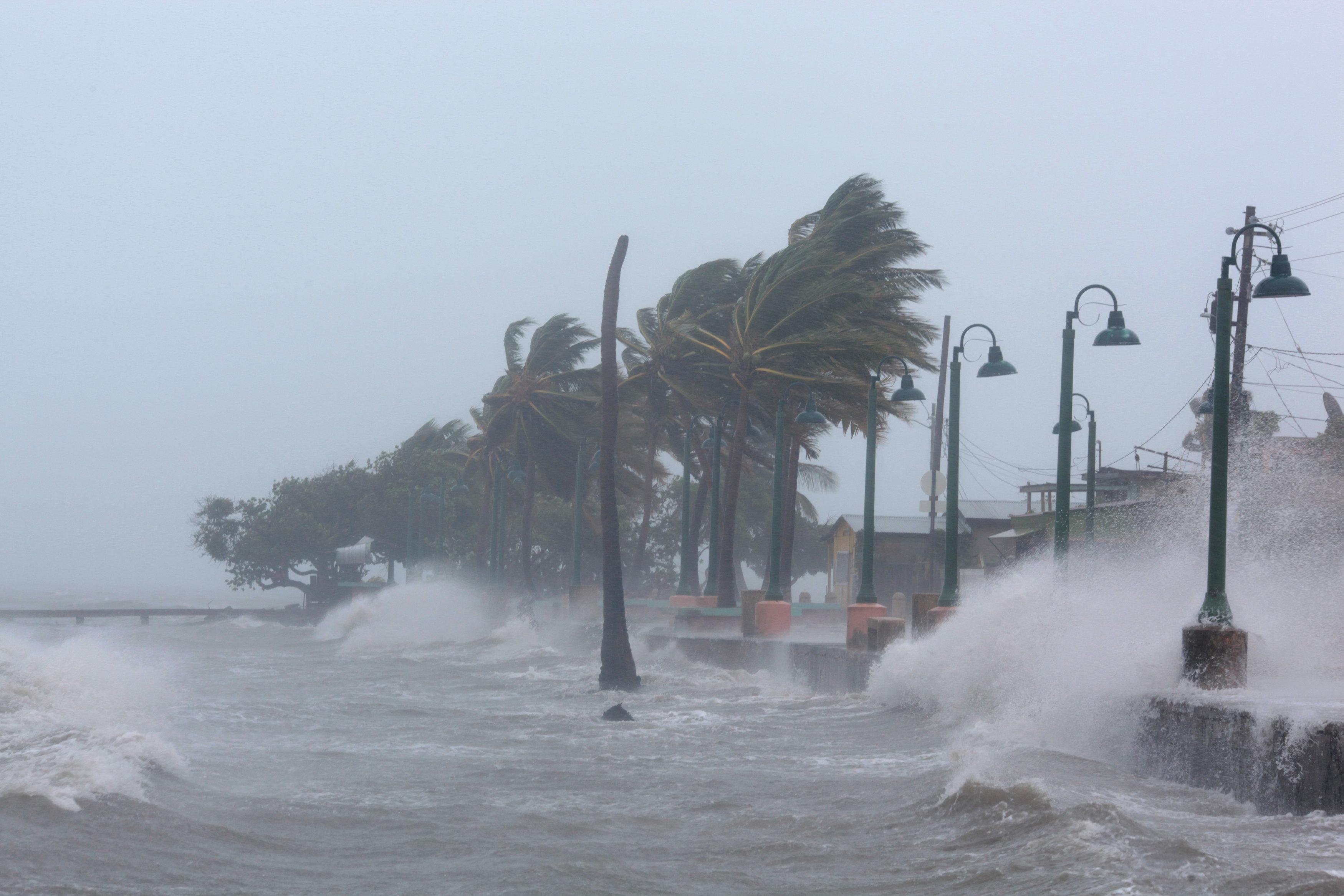 Waves crash against the seawall  in Fajardo, Puerto Rico. (REUTERS/Alvin Baez)