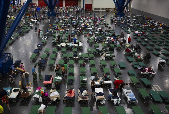 Evacuees fill up cots at the George Brown Convention Center that has been turned into a shelter run by the American Red Cross to house victims of the high water from Hurricane Harvey on August 28, 2017 in Houston, Texas. (Erich Schlegel/Getty Images)