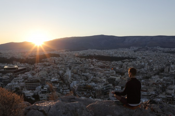 A man meditates on the Pnyx hill in Athens on Sept. 7, 2017. (LUDOVIC MARIN/AFP/Getty Images)