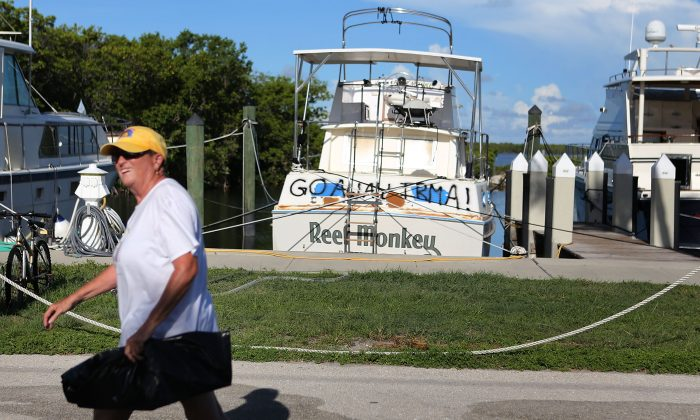 A woman at the Founders Park Marina continues to prepare for Hurricane Irma in Islamorada, Florida on September 7, 2017.The marina is on one of Florida's barrier islands already under mandatory evacuation order. It is all but empty except for a few main stays who refuse to leave. (Marc Serota/Getty Images)