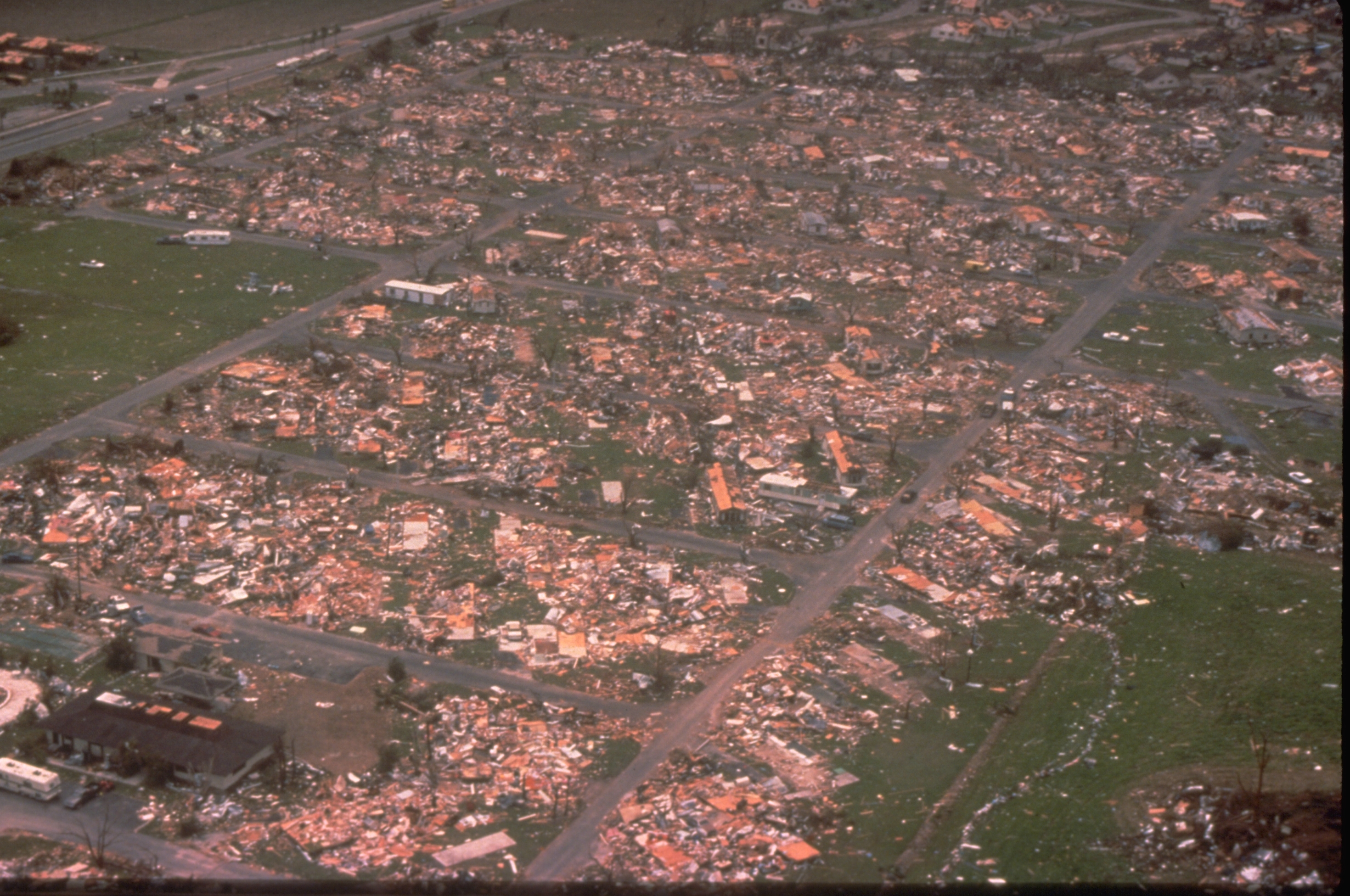 An aerial view ofDade County, Florida, shows the damage Hurricane Andrewwrought on a mobile home park when it struck in a large mobile home park in mid August, 1992. One million people were evacuated and 54 died in the hurricane. (Bob Epstein/FEMA News Photo/via Wikimedia Commons)