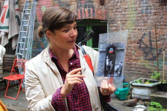 Stefanie Hempel, who does musical tours of St. Pauli, holds a picture of John Lennon. The Beatles got their start in Hamburg. (Wibke Carter)
