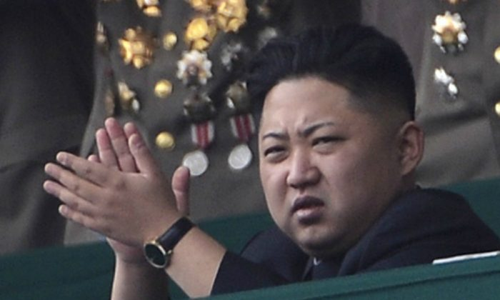 North Korean leader Kim Jong-Un (R) applauds during a official ceremony at a stadium in Pyongyang on April 14, 2012. (PEDRO UGARTE/AFP/Getty Images)