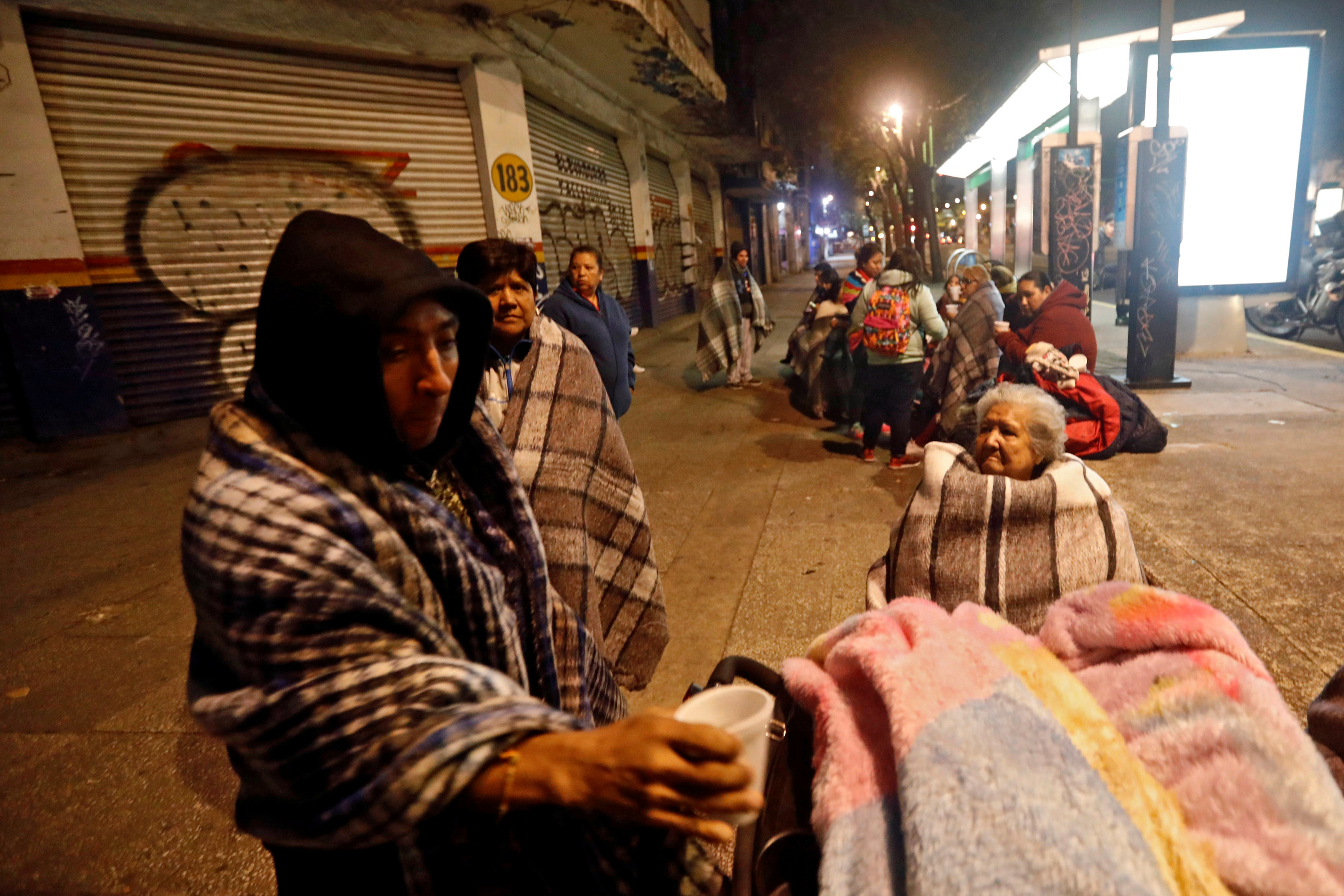 People gather on a street after an earthquake hit Mexico City, Mexico on Sept. 8, 2017. (REUTERS/Edgard Garrido)