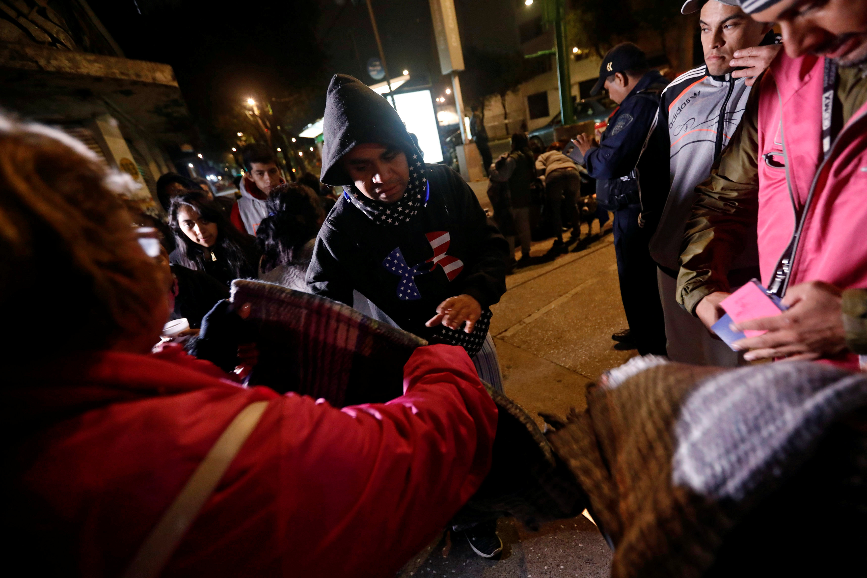 People gather on a street as they receive blankets after an earthquake hit Mexico City, Mexico on Sept. 8, 2017. (REUTERS/Edgard Garrido)