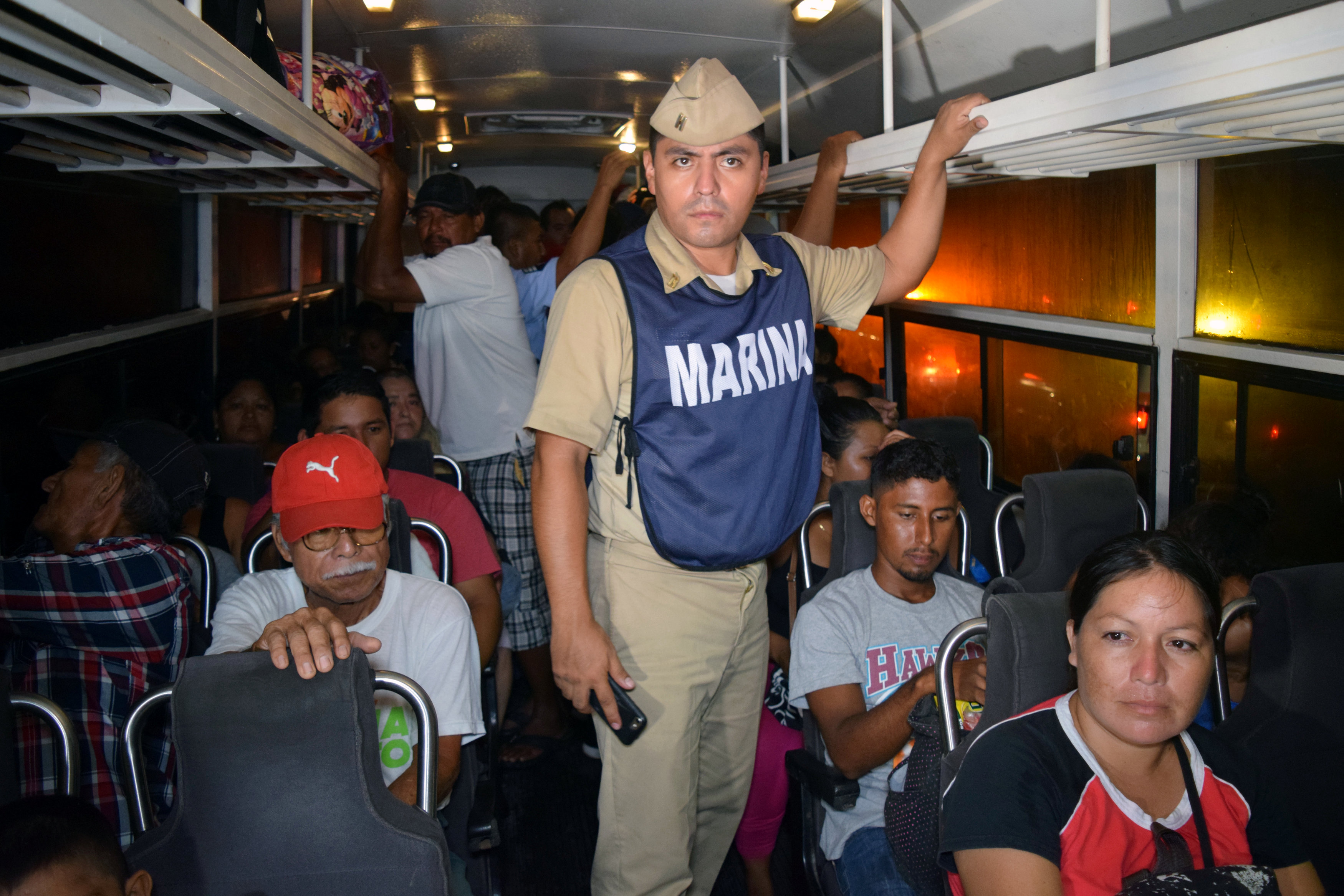 People are seen in a bus as they are being evacuated from their coastal town after an earthquake struck off the southern coast, in Puerto Madero, Mexico on Sept. 8, 2017. (REUTERS/Jose Torres )NO RESALES. NO ARCHIVES