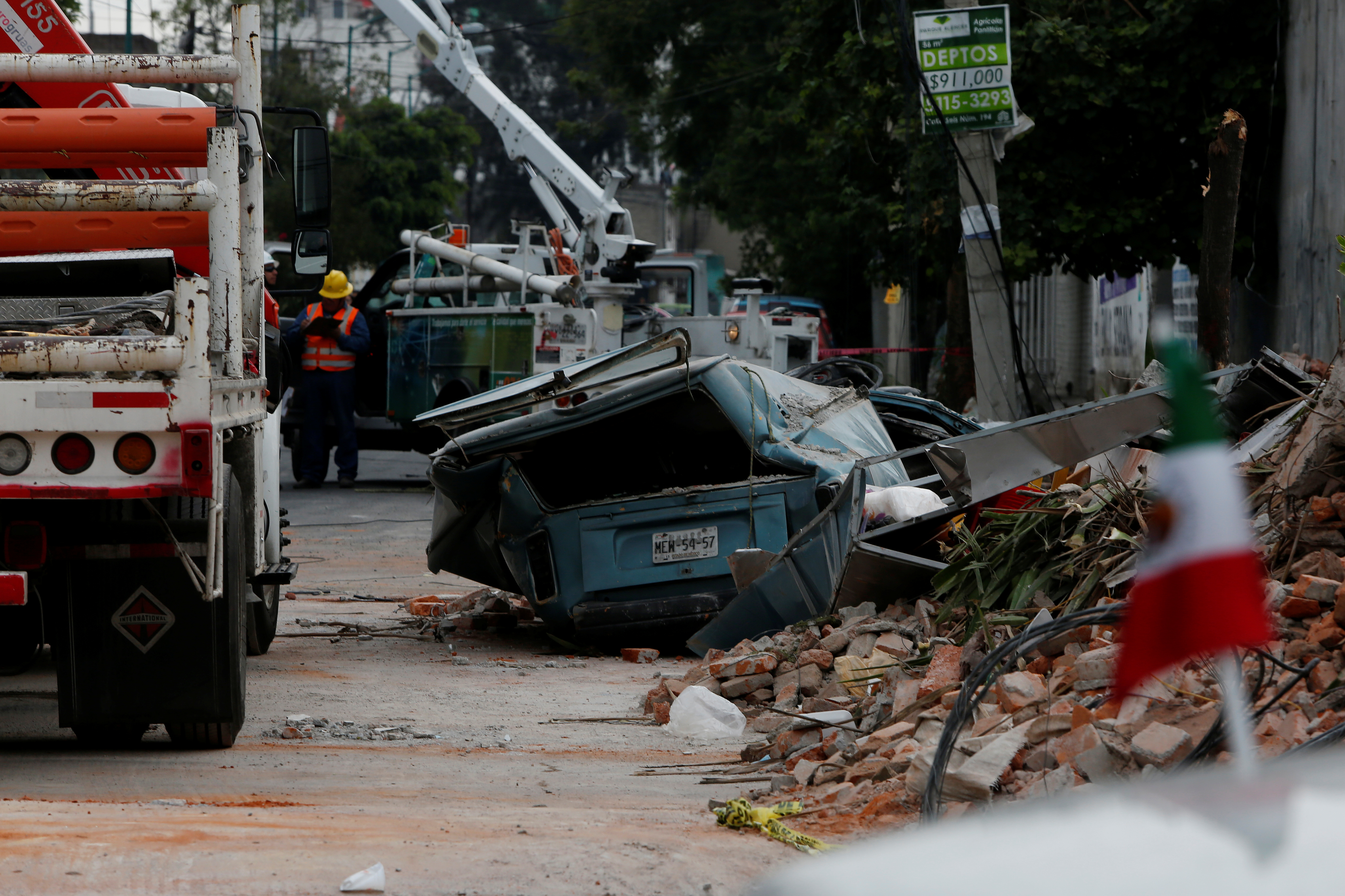 A damaged wall and a smashed vehicle are pictured after an earthquake in Mexico City, Mexico on Sept. 8, 2017. (REUTERS/Carlos Jasso)