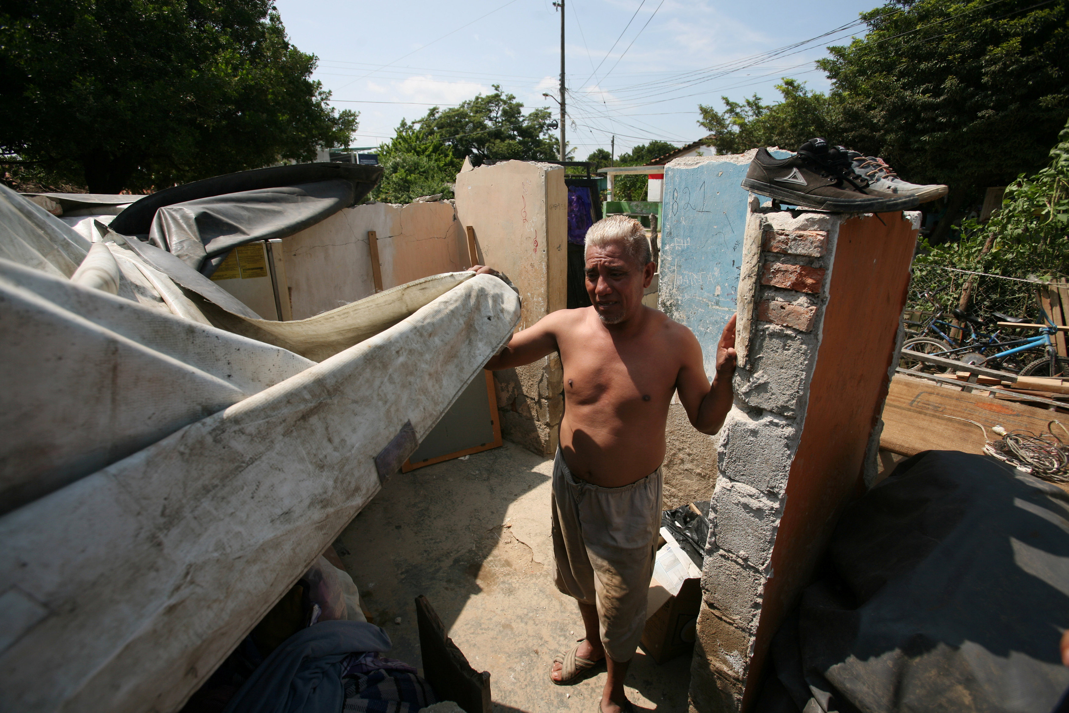 A man stands inside of what his left of his home after an earthquake struck the southern coast of Mexico in Union Hidalgo, Mexico on Sept. 9, 2017. (REUTERS/Jorge Luis Plata)