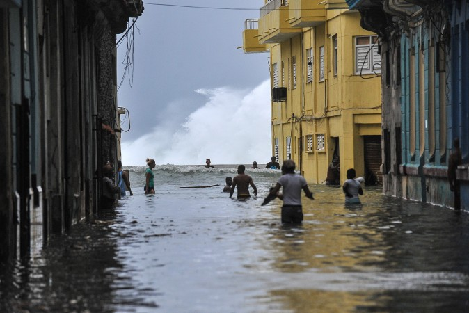 Cubans wade through a flooded street near the Malecón in Havana on Sept. 10, 2017, after Hurricane Irma battered central Cuba on Saturday. (YAMIL LAGE/AFP/Getty Images)