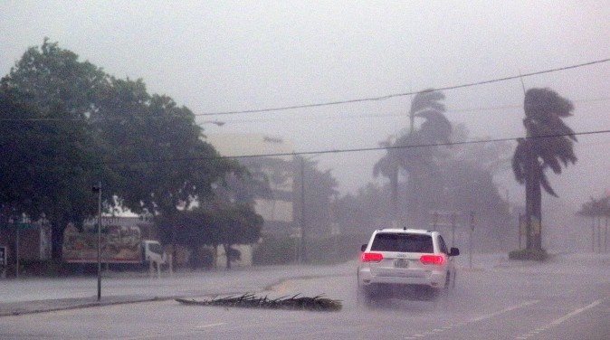 BOCA RATON, FL - SEPTEMBER 10: A lone car drives down a road as Hurricane Irma strikes on September 10, 2017 in Boca Raton, Florida. Hurricane Irma made landfall in the Florida Keys as a Category 4 storm today, lashing the state with 130 mph winds as it moves up the coast. (Marc Serota/Getty Images)