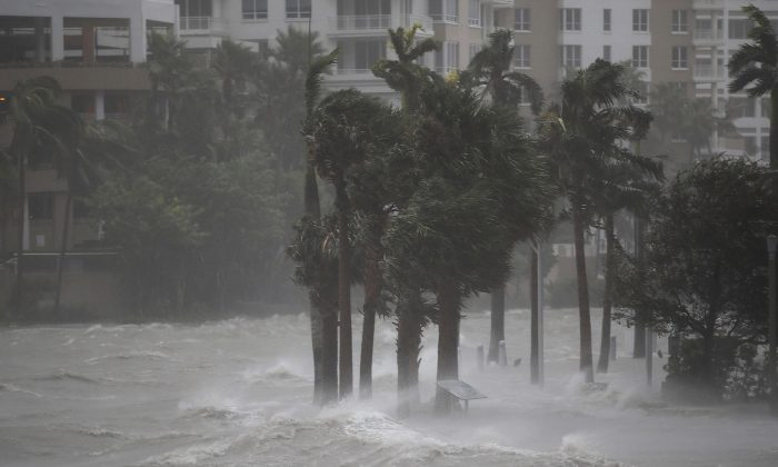 Water flows out of the Miami River to flood a walkway as Hurricane Irma passes through on September 10, 2017 in Miami, Florida. (Joe Raedle/Getty Images)