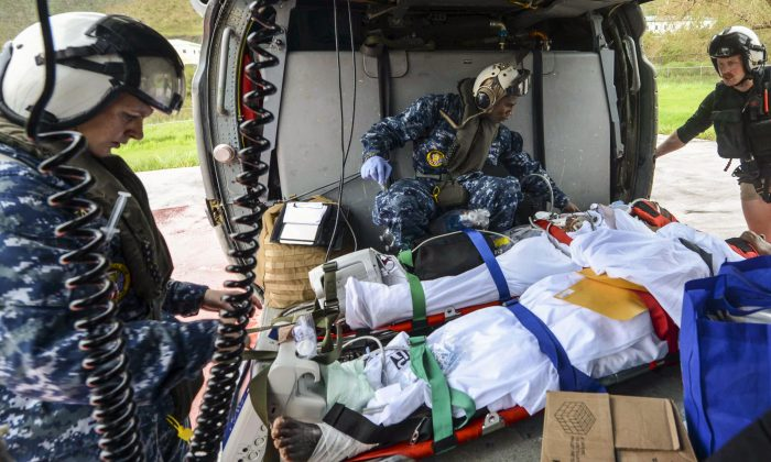 Sailors place evacuees in a Seahawk helicopter during first response efforts in the U.S. Virgin Islands on Sept. 7, in the aftermath of Hurricane Irma. (U.S. Department of Defense)