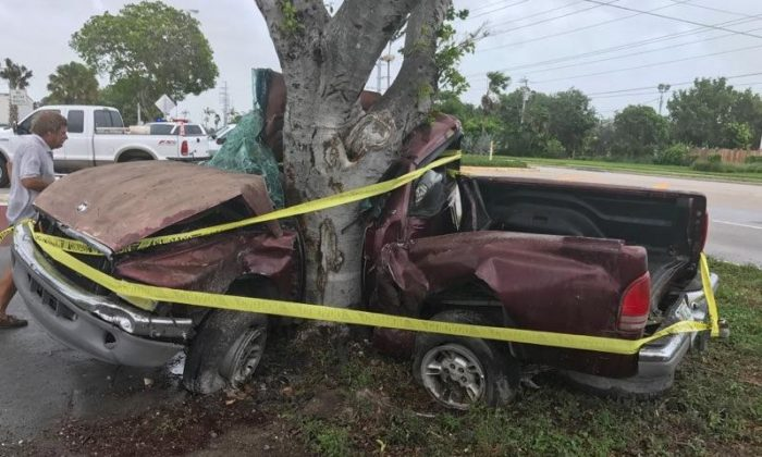 A man died when his pickup truck crashed into a tree in the Florida Keys during Hurricane Irma in Florida, U.S. in this handout photo obtained by Reuters September 10, 2017.  Monroe County Sheriff's Department/Handout via REUTERS