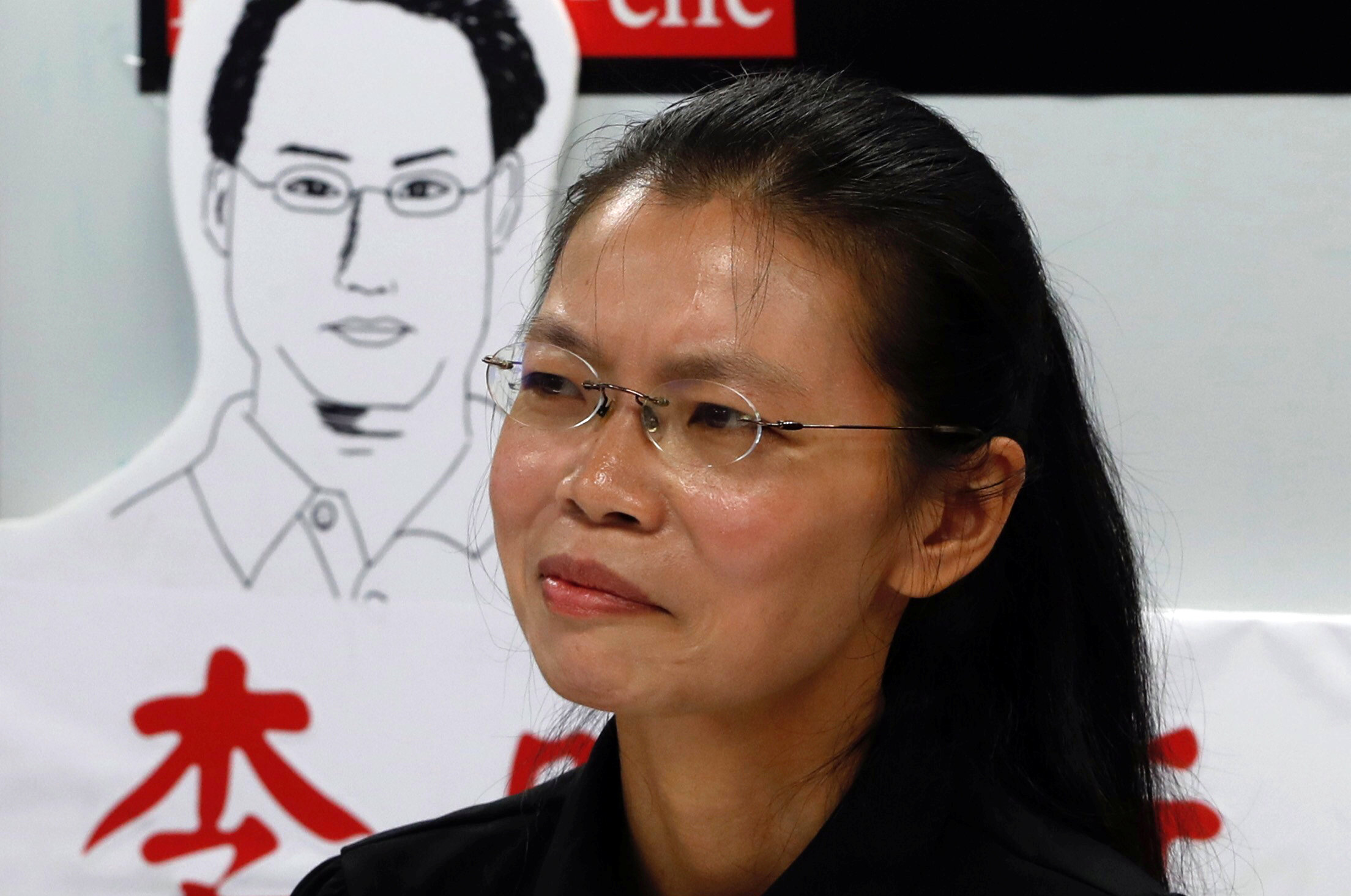 Lee Ching-yu, wife of Taiwan human rights advocate Lee Ming-che, who has been detained in China, speaks to the media a day before departing for her husband's trial, in Taipei, Taiwan on Sept. 9, 2017. (REUTERS/Tyrone Siu)