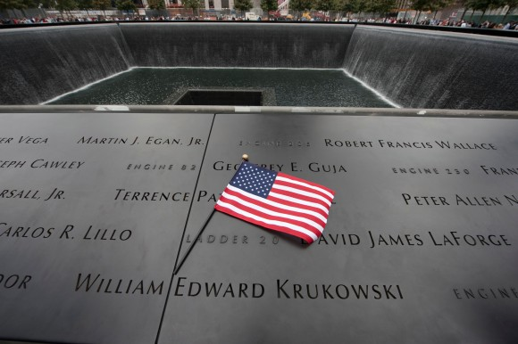 A US flag at the memorial wall on the South Tower reflecting pool of the World Trade Center September 11, 2011 in New York. AFP PHOTO/DON EMMERT / AFP / DON EMMERT (Photo credit should read DON EMMERT/AFP/Getty Images)