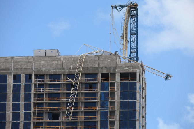 A collapsed crane on a building under construction is pictured after passing of Hurricane Irma in Key Biscayne, Florida on Sept. 11, 2017. (REUTERS/Carlo Allegri)