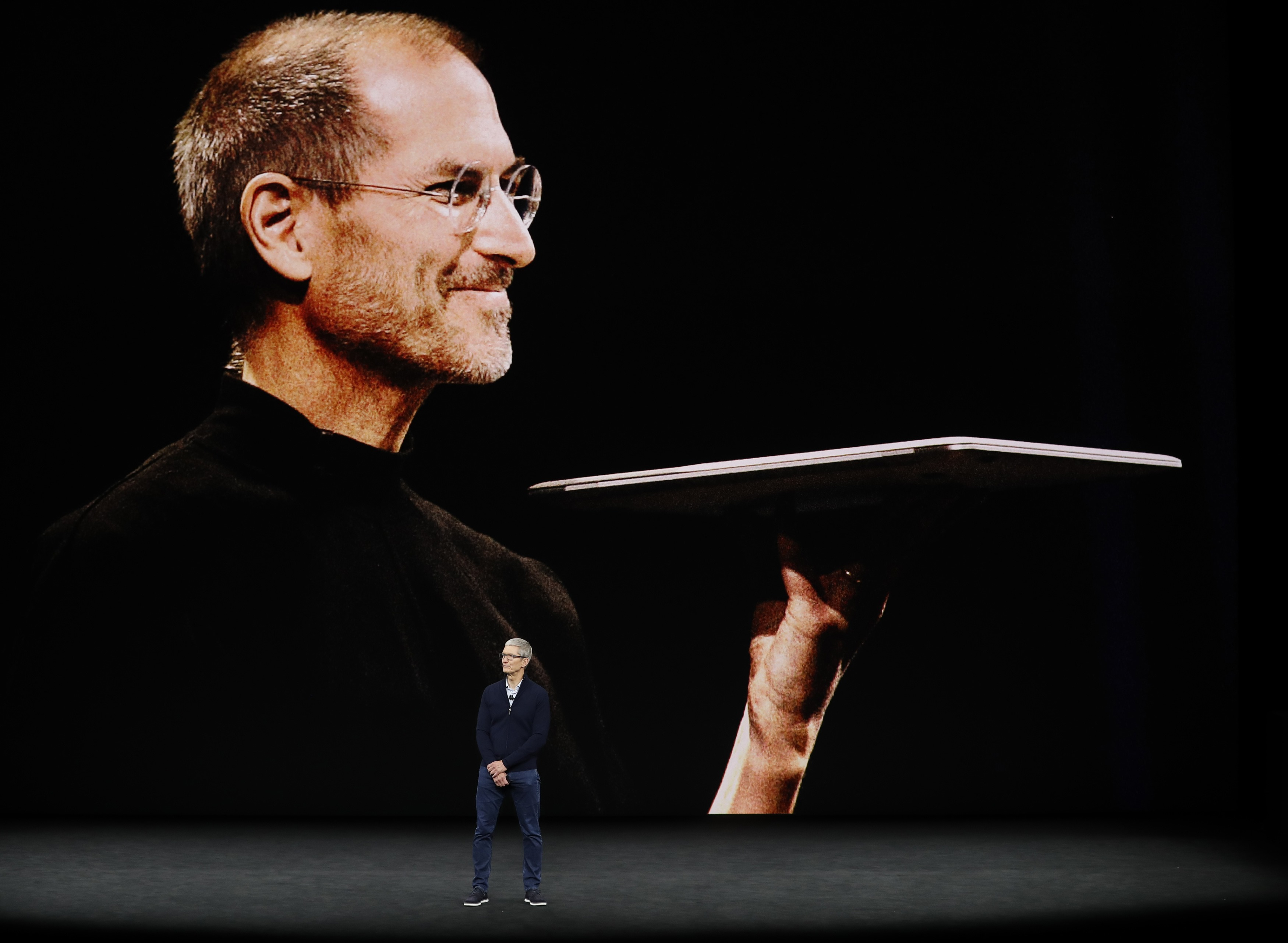 Tim Cook, CEO of Apple, speaks as a tribute video to the late Apple co-founder Steve Jobs plays behind him during a product launch event in Cupertino, Calif., on Sept. 12, 2017. (REUTERS/Stephen Lam)