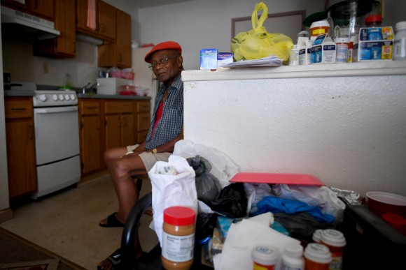 Two days after Hurricane Irma, William James, 83, sits without power, food or water, in his room at Cypress Run, an assisted living facility, in Immokalee, Florida, U.S., September 12, 2017. (Reuters/Bryan Woolston)