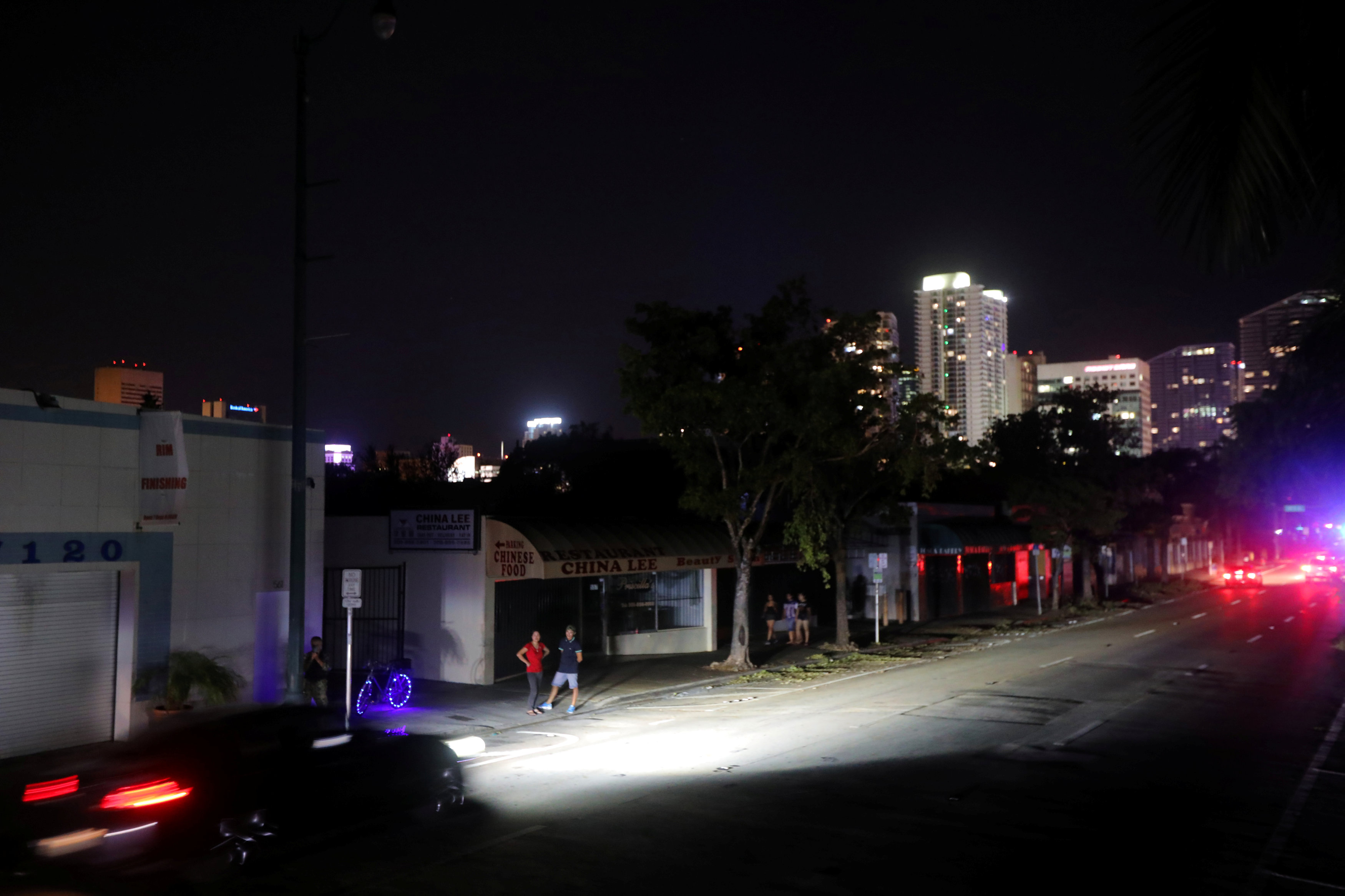 Local residents stand in the darkness as many areas of Miami still without electricity after Hurricane Irma strikes Florida, in Little Havana, Miami, Florida on Sept. 11, 2017. (REUTERS/Carlos Barria)