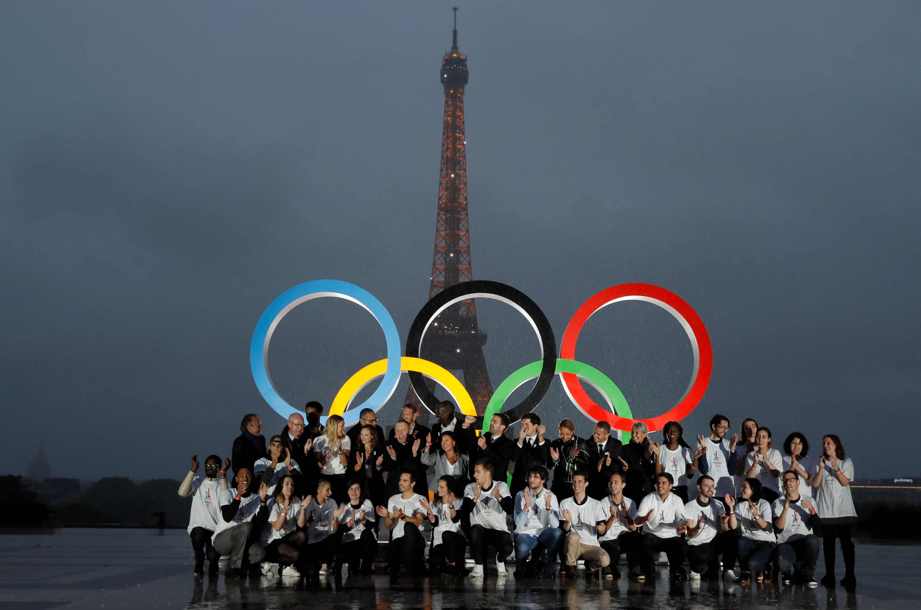 Parisians, athletes and officials pose in front of Olympic rings to celebrate the IOC official announcement that Paris won the 2024 Olynpic bid during a ceremony at the Trocadero square in Paris, France, on Sept. 13, 2017.(REUTERS/Gonzalo Fuentes)