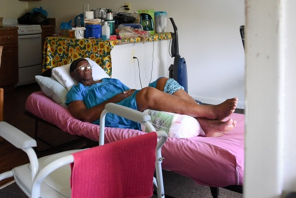 Two days after Hurricane Irma, Mary Mitchell, 82, lays on a hospital bed in her room, without power, food, or water at Cypress Run, an assisted living facility, in Immokalee, Florida, U.S., September 12, 2017. Picture taken September 12, 2017. REUTERS/Bryan Woolston