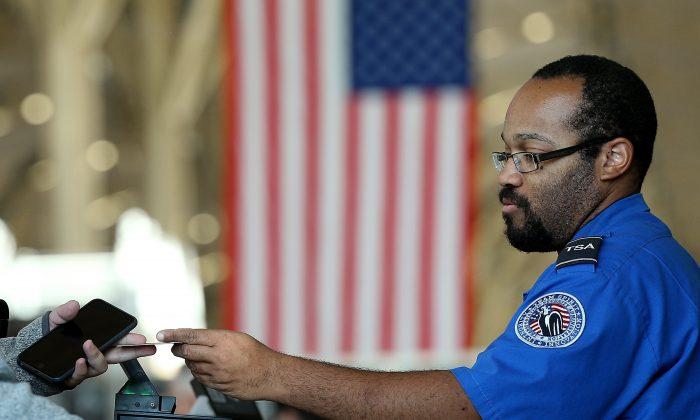 A TSA officer checks travel documents at Reagan National Airport in Arlington, Va., Nov. 25, 2015. (Win McNamee/Getty Images)